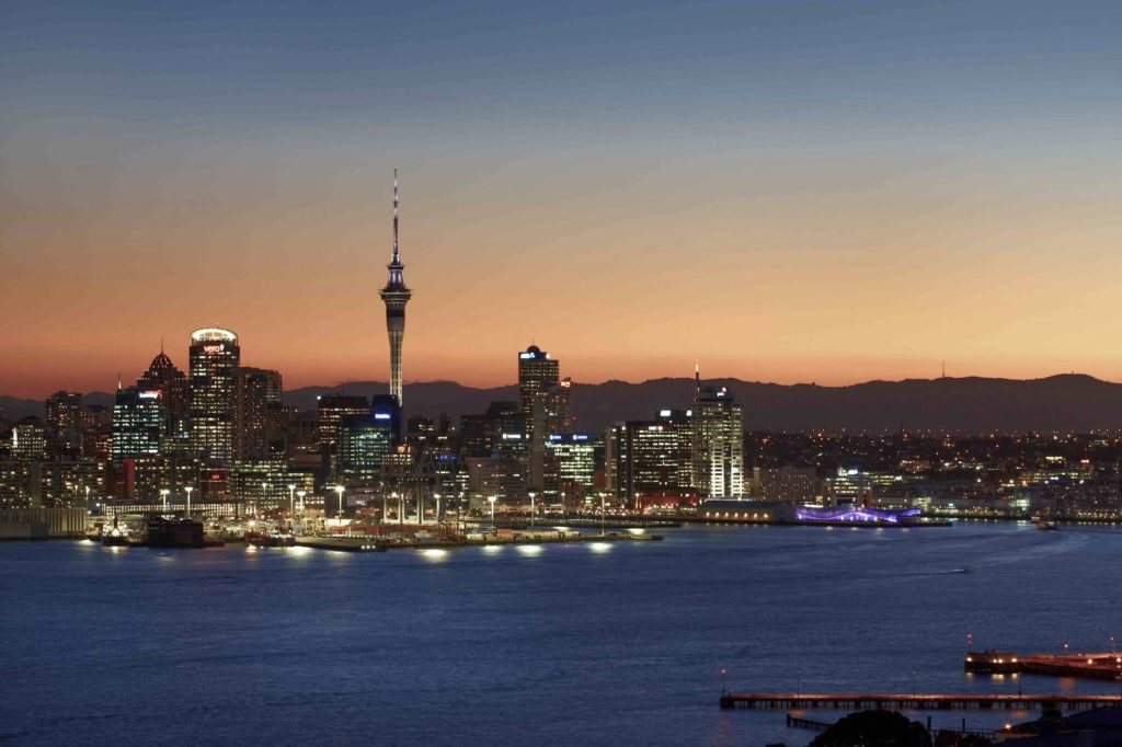 Auckland skyline at sunset with the Sky Tower standing tall