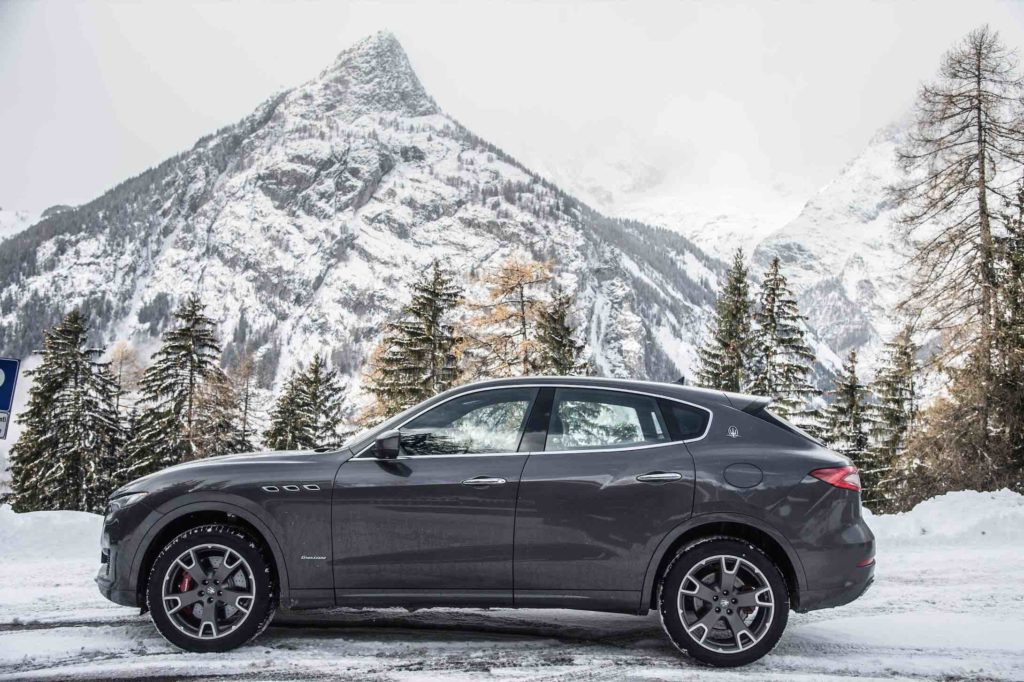 The Maserati Levante GranLusso pictured with a snowy mountain in Courmayeur Italy