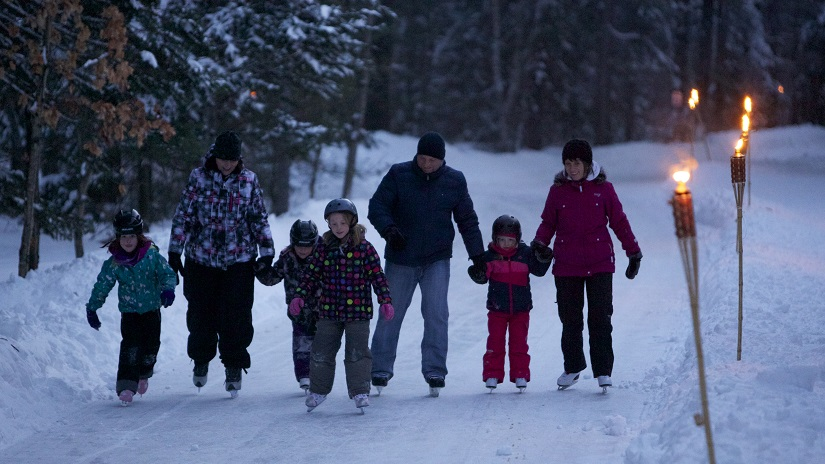 The Ice Skating Trail at Arrowhead Provincial Park showing family skating at night