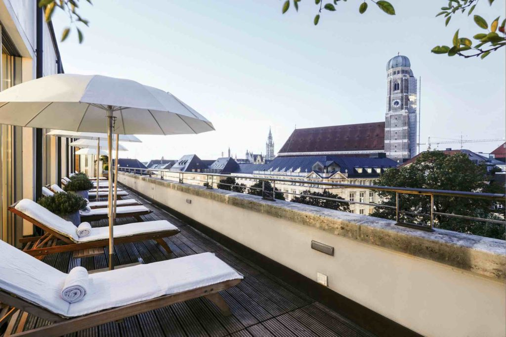 Blue Spa Munich with incredible view from lounge chairs over the city and a nearby church