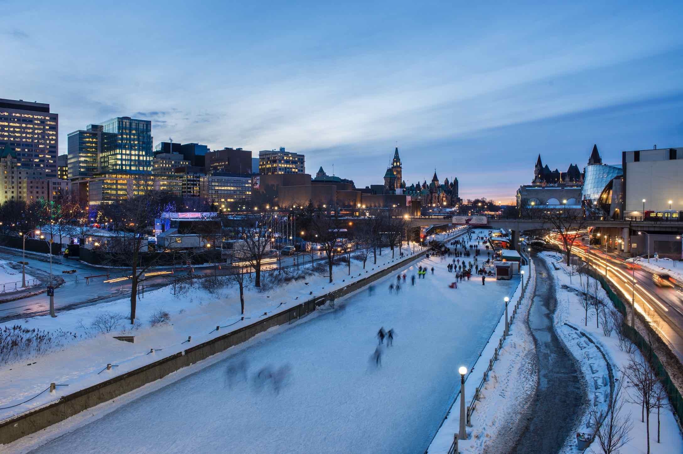 Skating on the Rideau Canal in Ottawa at night, one of the top things to do in Ontario in winter
