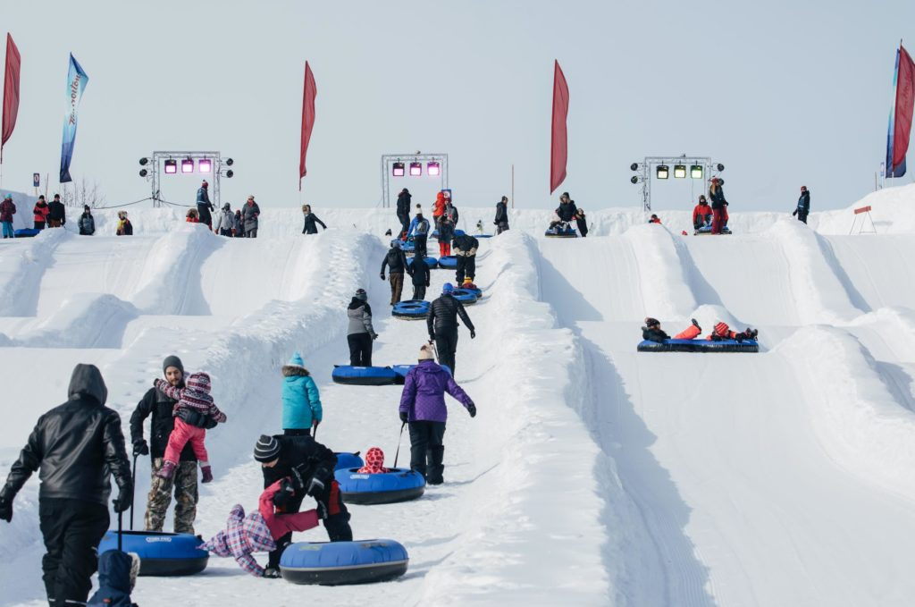 Families enjoying the snow tube slopes at Ottawa's Winerlude