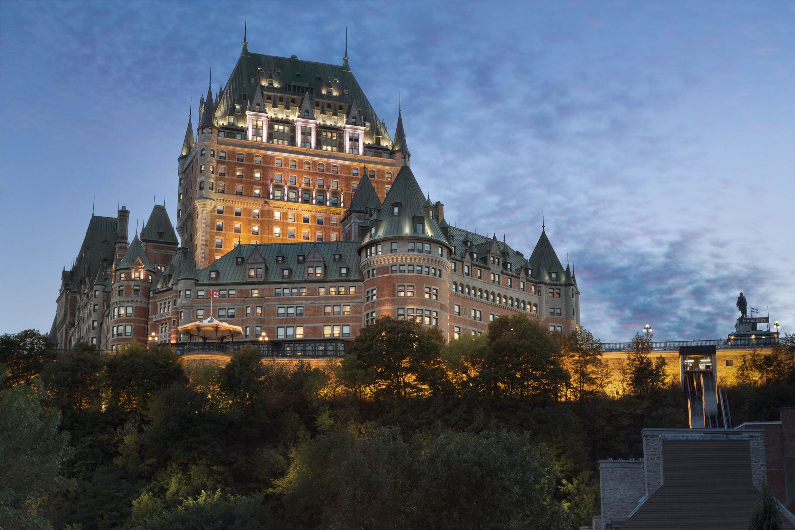 Dramatic exterior shot of Chateau Frontenac in Quebec City at night