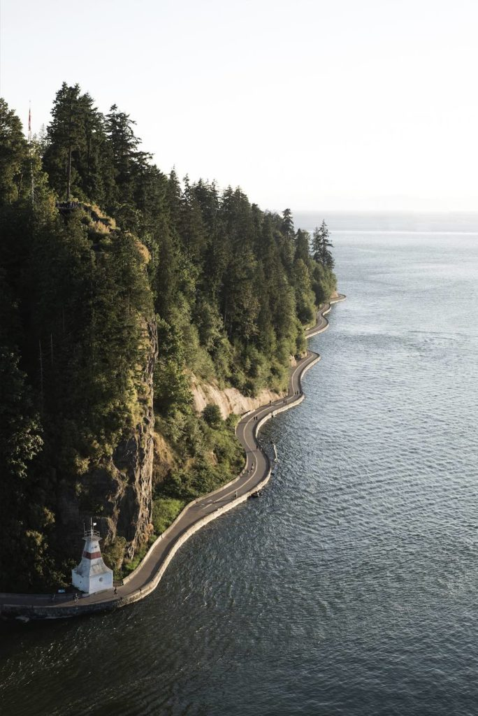 Biking along the coastal path in Stanley Park, shown here, is a top thing to do in Vancouver