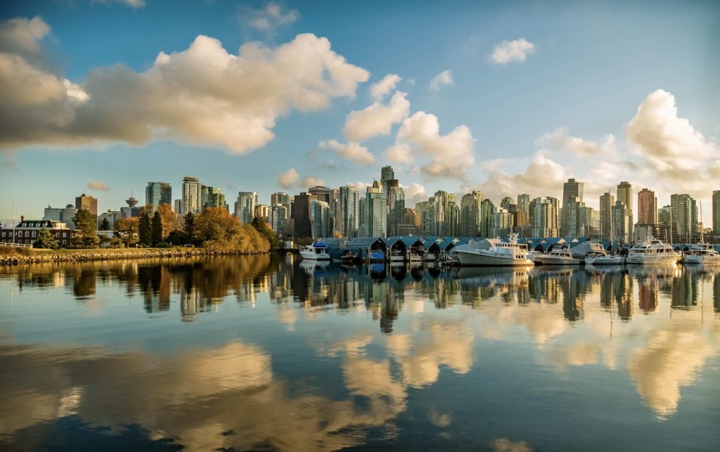 Vancouver skyline with fun things to do including boating at a marina pictured here on a sunny day