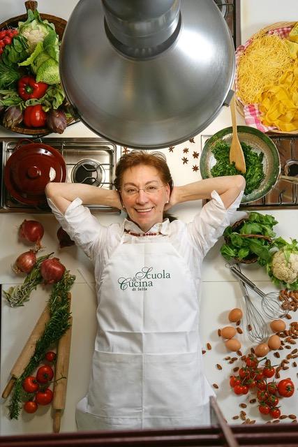 Lella Cesari Ciampoli lying down amongst ingredients