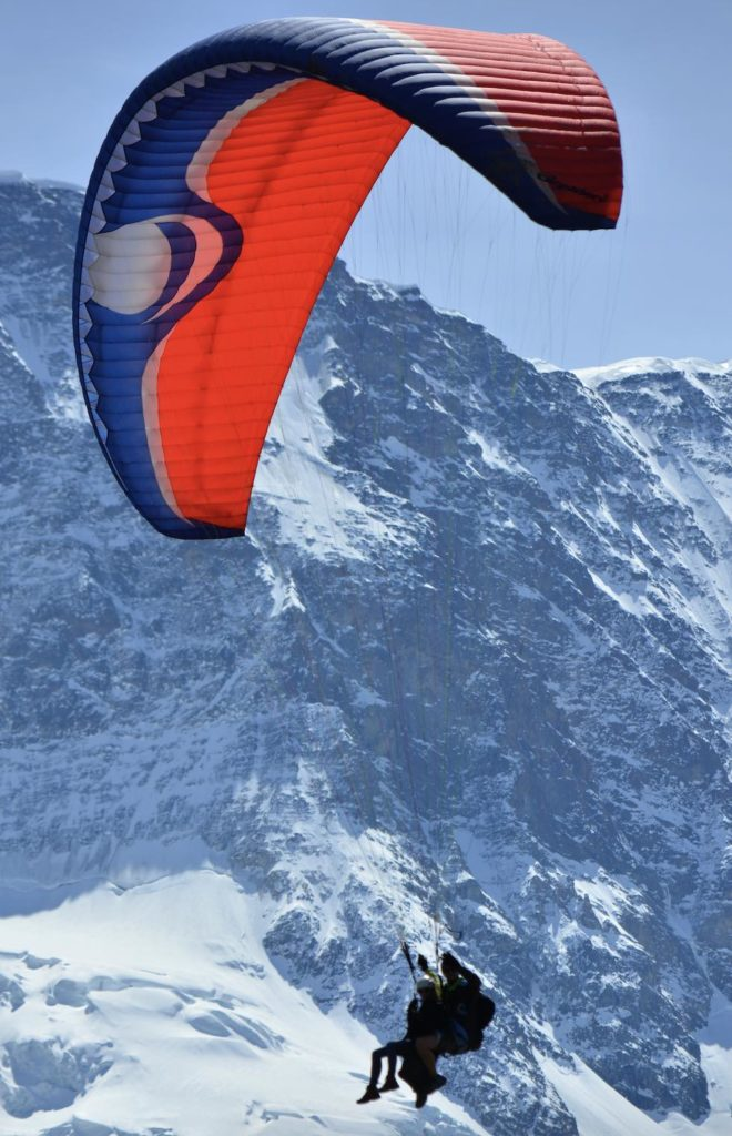 Swiss Alps paragliding experience showing two people in flight