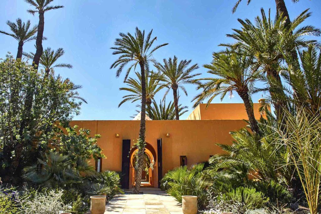 The entrance way to Jnane Tamsna Boutique Hotel on a bright sunny day