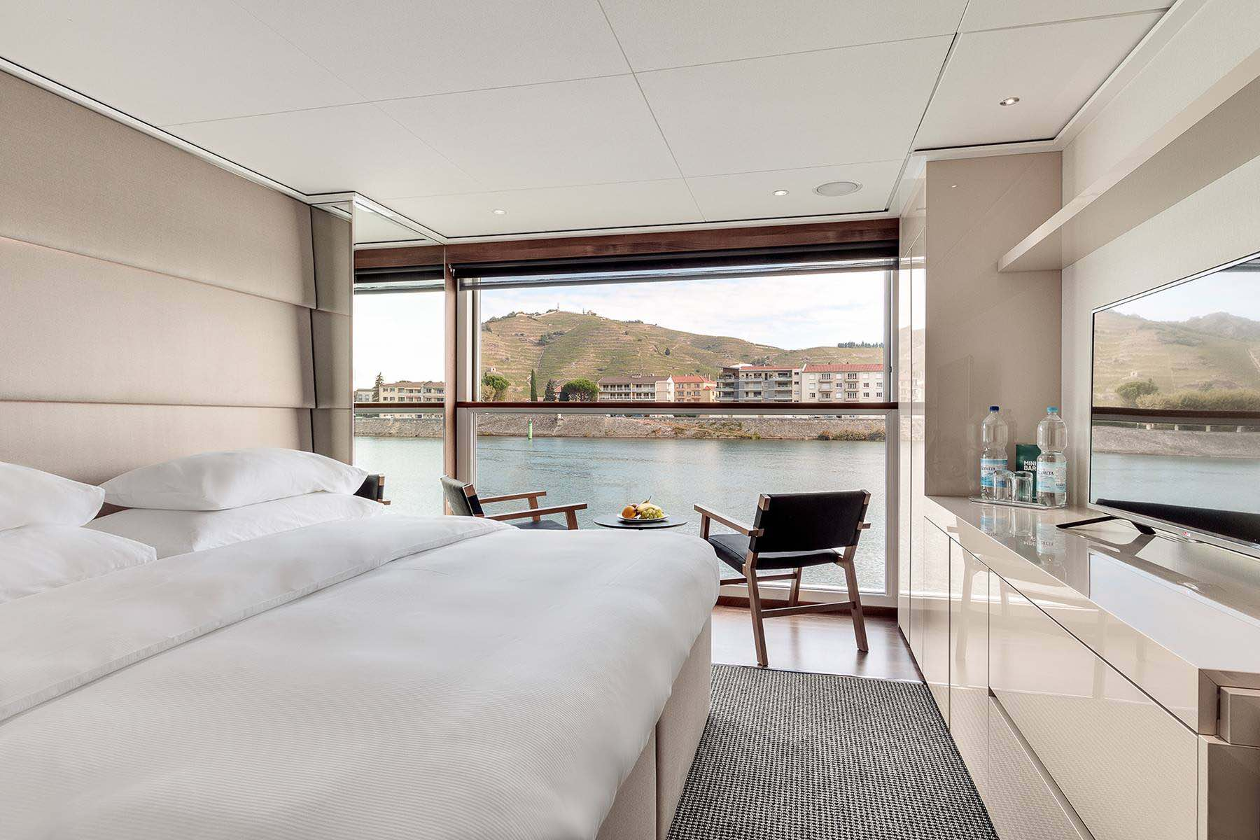 Luxury suite with river view aboard Rhone river cruise