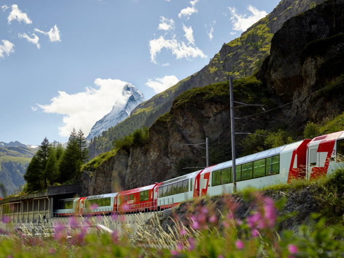 The Glacier Express with Matterhorn in background as part of a fun Swiss Alps paragliding adventure