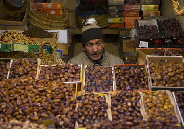 A shopkeeper selling figs at Fez Medina