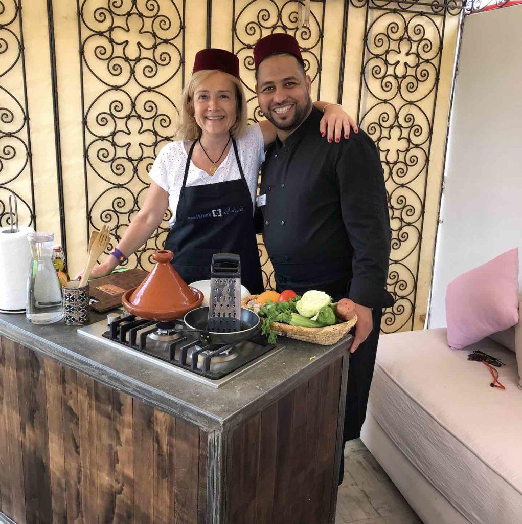 Author Gina Baska and chef at Palais Amani's cooking school
