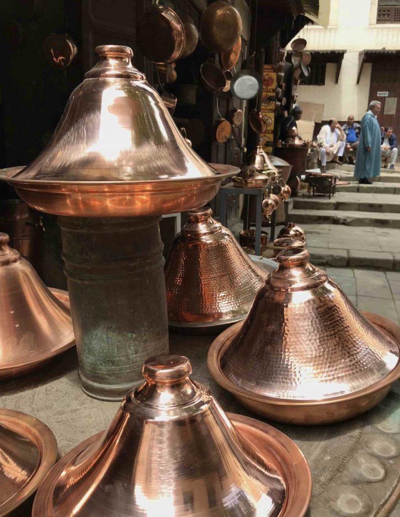 Shopping for copper pots in Fez medina near Palais Amani