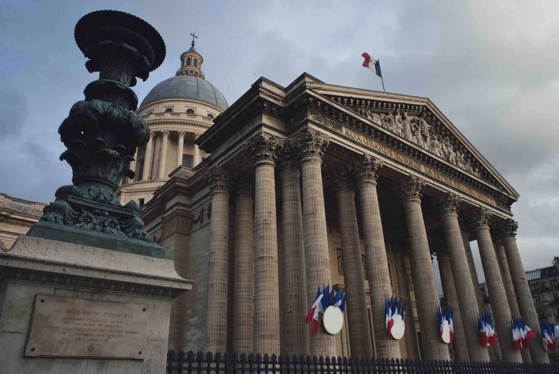 Top things to do in Paris for book lovers include visiting the famous Pantheon, shown here with French flags