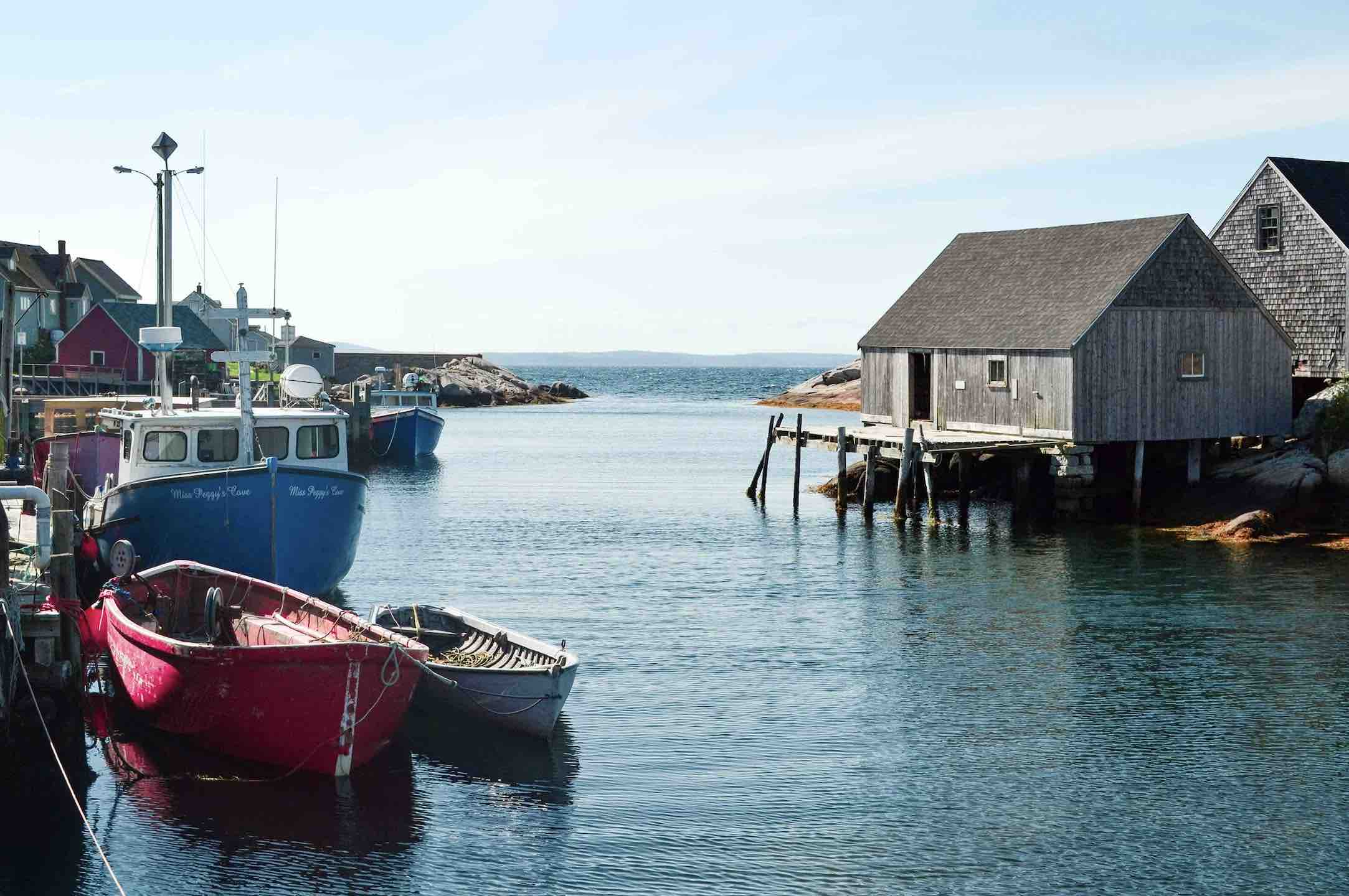 Fishing boats and huts in harbour and PEI mussels