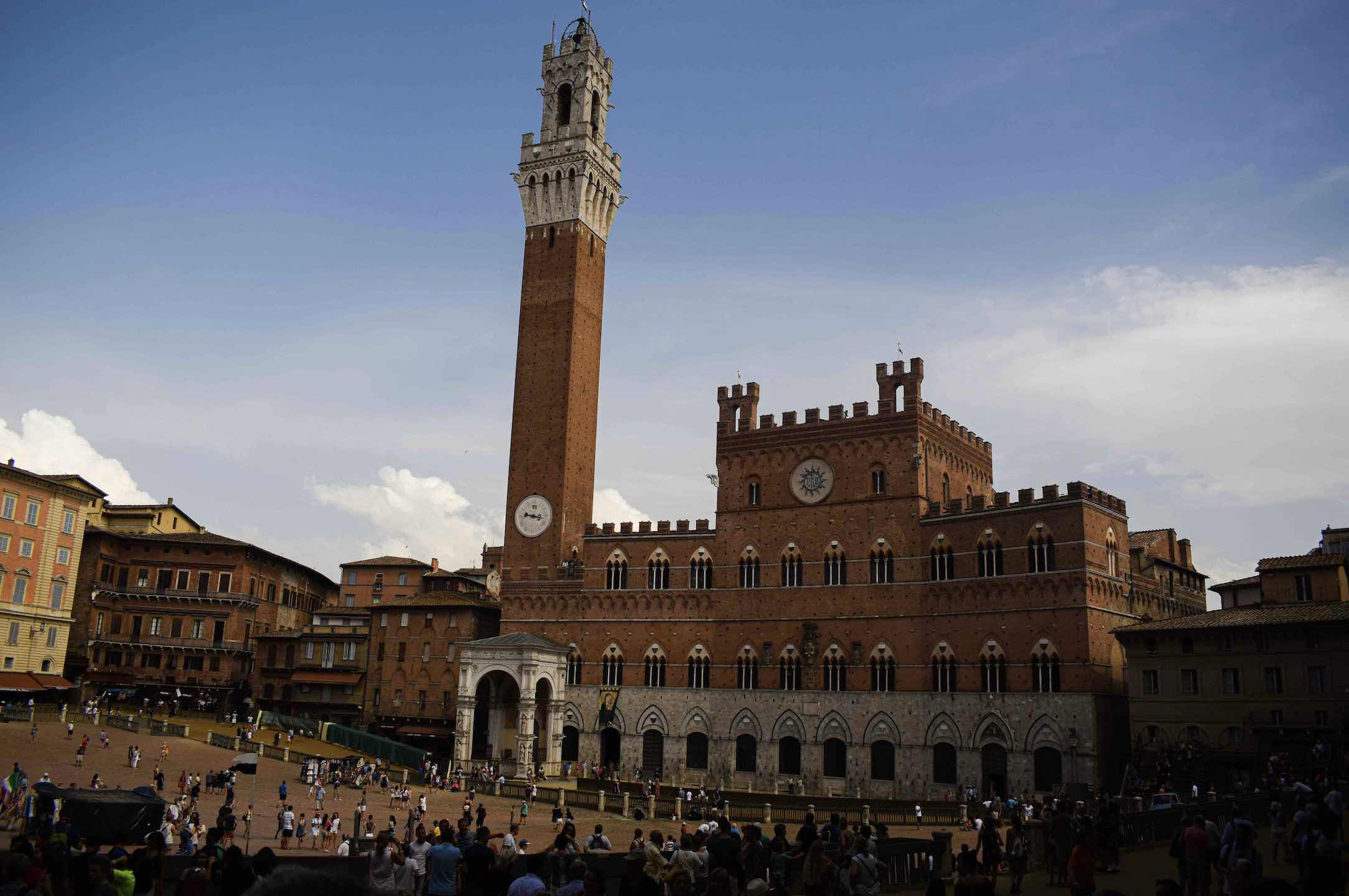 Pull up a chair and enjoy people watching at Siena's Piazza del Campo shown here in summer